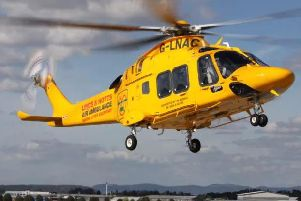 The woman was airlifted to hospital following the crash
