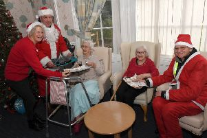 Sleaford All Knighters scooter club members dressed as santas, ride from Barge and Bottle to Roxholm Hall Care Centre. L-R Gill Freear - home manager, Paul Franks, Margaret Foreman - resident, Violet Crossland - resident, Roy Workman. EMN-181217-110355001