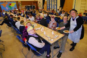 Horbling Brown's School headteacher Sally Howley helping serve up Christmas lunches to pupils and invited villagers. EMN-181219-152622001