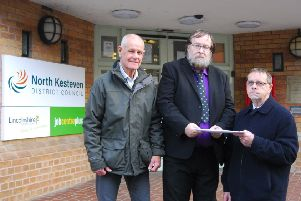 Sleaford Indoor Bowls Club representatives hand over their petition to North Kesteven District Councillor David Suiter. EMN-190115-091230001