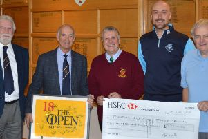 Presenting the donation. From left - Lincolnshire Freemasons' Golf Association chairman Terry Little, raffle winner Ed Walters,'Nick Musson, Junior Organiser at Sleaford Golf Club Dougie Coote and Association Secretary Mick Wright. EMN-190118-135823001