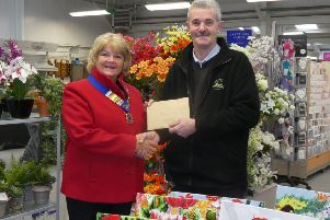 Tim McLeod-Rice of Anwick Garden Centre presenting the �750 cheque to Sleaford Lions President Sue La Roche. EMN-190129-152325001