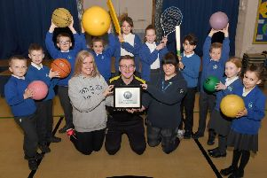 St Botolph's School, Platinum School Games Mark. Pupils pictured with L-R Emma Bellaby - deputy head, Alex Smith - active school co-ordinator, Kerry Duncan - PE co-ordinator. EMN-190124-175927001