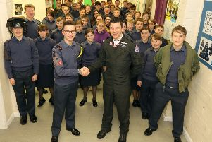Flt Lt Jim Peterson is thanked for his visit to Sleaford ATC by Cadet Warrant Officer Sam Hurry - the most senior cadet in the unit. EMN-190215-161559001