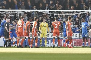 Posh striker Ivan Toney (right) is about to get sent off in the game against Shrewsbury. Photo: David Lowndes.