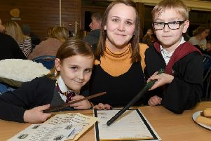 Harry Potter night at Horbling Brown's School. L-R Frankie Atkins 6, Sian Atkins, Mason Atkins 7. EMN-190802-095537001