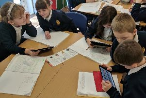 Children in Daffodils Class at Browns School, Horbling,researching metals for their Mighty Metals topic. EMN-190226-113158001