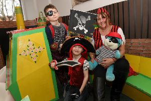 Pirate themed crafts and stories at Sleaford Library. Cultural Services advisor Helen Keeping with L-R Jenson Middleton 6 and Dexter Pell 5. EMN-190226-094318001