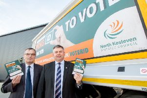 NKDC Chief Executive Ian Fytche (left) and Leader Coun Richard Wright launch the district's voter ID pilot using posters on bin lorries. EMN-190226-133451001