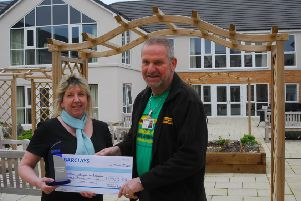 Holdingham Grange manager Hazel Whittaker presents the healthcare design award ?500 prize money to chosen charity, the Lincs and Notts Air Ambulance> It was accepted by volunteer and former recipient of its services, Mark Desmond. EMN-190103-173925001