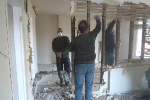 Volunteer villagers hard at work on renovations at The Thorold Arms, Harmston. EMN-191003-160502001