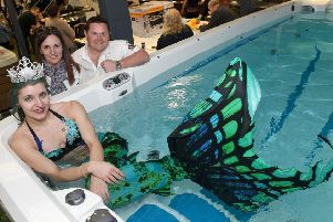 1Stop Spas, Billinghay. Tenth anniversary open event. Owners Chris and Melissa Brady with Laura Hudson (Mermaid Twinkle) of Donington, Miss Mermaid Lincolnshire, England and Uk. EMN-190403-101949001