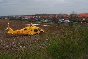 The air ambulance landed in a nearby field to provide assistance. EMN-190327-152640001