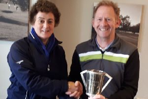 Lady captain Nancy Denny presents overall winner Paul Gough with the Autumn Trophy EMN-190904-094455002