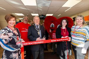 Mayor of Sleaford Coun Grenville Jackson cuts the ribbon to open the new British Heart Foundation shop in Sleaford. From left - (front) Maria Quirke (Store Manager), Christopher Stocks (volunteer) Coun Grenville Jackson (Mayor of Sleaford), Amelia Dobson (Assistant Manager at Sleaford) and Niki Elliott (Area Manager). EMN-191104-151628001