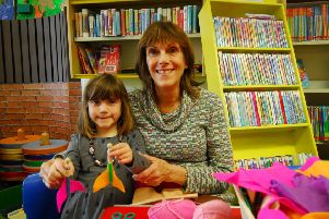 Jan Mathieson with granddaughter Celeste Mathieson-Bright making mermaid peg dolls at Sleaford Library. EMN-191204-151631001