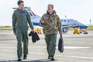 Instructor Sqn Ldr Ian Birchall and Flying Officer Jake Weeks after the first training sortie in one of RAF College Cranwell's new Phenom ZM333 aircraft used by 45 Sqn. Photo: Gordon Elias EMN-191104-175610001
