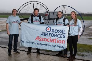 From left - paramotorists Paul Mockford and Flight Lieutenant Giles Fowler with their support crew Andy Greaves and Katie Pagett. EMN-191104-165511001
