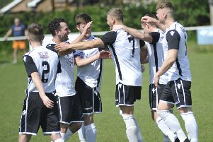 Bexhill United celebrate their opening goal in Easter Monday's 2-0 win away to Hailsham Town. Picture by Simon Newstead