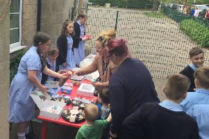 Rauceby School councillors and ambassadors holding the fundraising bake sale to help a school in Gainsborough targeted by thieves who stole their chickens. EMN-190430-105755001