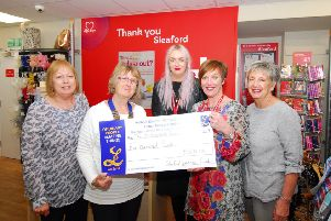 Sleaford and District Lionesses present the money to British Heart Foundation managers at the new sleaford charity shop in Southgate. EMN-190205-110538001