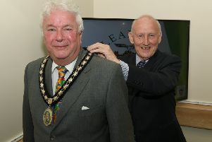 Sleaford Town Council elect new mayor Coun Adrian Snookes, receiving his chain of office from outgoing mayor Grenville Jackson. EMN-190516-132934001