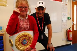 Lincoln boxer Nathan Decastro allowed Nocton School pupils to try on his WBU winners belt during his visit. EMN-190521-125636001
