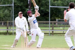 Cropredy batsman Joe Haynes plays his shot as Minster Lovell wicket keeper James Merryman looks on. Photo: Steve Prouse