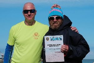 Paul Harris (right) receives his certificate for completing the British Long Distance Swimming Association (BLDSA) Champion of Champions Swim