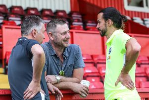 Posh boss Darren Ferguson, chairman Darragh MacAnthony and new signing George Boyd at Stevenage. Photo: Joe Dent