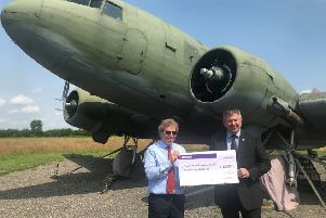 Coun Richard Wright (right) presents a cheque for �5,000 to Andrew Scoley, chairman of the Friends of Metheringham Airfield, for the new hangar for the Dakota. EMN-190724-115537001