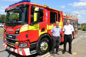 Chief Fire Officer for Lincolnshire, Les Britzman, pictured with Coun Nick Worth, portfolio holder for emergency services at the county council, and one of the new fire appliances. EMN-190730-152851001