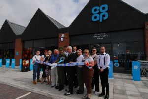 Mayor Adrian Snookes and Deputy Mayor Anthony Brand join manager Rob Taylor and staff at the opening of the new Co-op store in Handley Chase, Sleaford. EMN-190208-155659001