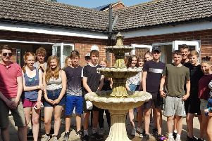 NCS team members in the completed garden project at St Andrew's Nursing Home, Ewerby. EMN-190726-140606001