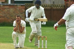 Melton First XI captain Mike Roberts watches a ball dispatched to the boundary EMN-190813-103637002