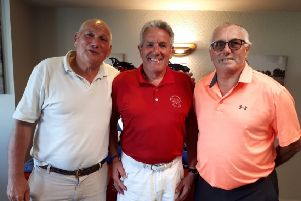 James Denny (left), part of the Seniors Open winning team, with club captain Gerry Stephens and John Squires (right) after his ace EMN-190813-133501002