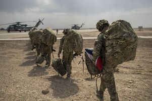 British troops walking out towards helicopter as they left Camp Bastion, Helmand Province, Afghanistan in 2014