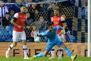 Simon Sluga saw this throw lead to Sheffield Wednesday's winner on Tuesday night