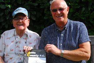 Les Stancer and Les Gadd with the history book on Notts County FC. EMN-190209-161637001