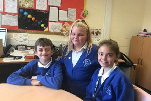 Pupils who helped launch Young Friends Against Scams (from left) Oliver Curtis, Summer Pettitt and Summer Watson).