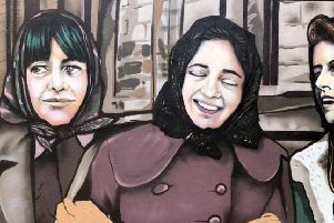 One of the new murals capturing the camaraderie among Londonderry's factory girls