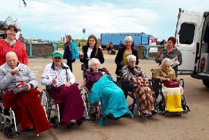 Greenacres residents and staff at the seaside thanks to help from TASL's ambulance crews. EMN-190909-133854001