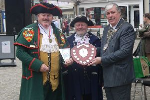 Sleaford Town Crier John Griffiths (left) receives his winner's trophy at the Otley Town Crier Competition. EMN-190924-151647001