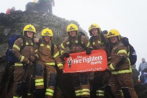 The firefighters reach the summit of Mount Snowdon in their full kit. Pictured, from left, is Ollie Baldham, Ben Gleadhill, Daniel Cheetham, Charlie O'Neil and Sam Newlyn.