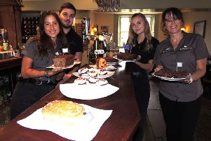 Serving up cakes for Macmillan's coffee morning at The Bustard Inn, Rauceby, from left - Robyn Clermont, Matt Grinney, Olivia Balchin and landlady Lesley Lonsdale. EMN-190930-144853001