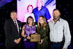 Leader of NKDC Coun Richard Wright, with special award recipients Wendy, Abbie and Stephen Coy of South Kyme.