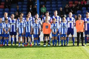The mascots with the team.