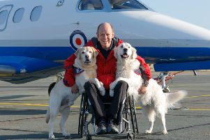 Allan Parton with EJ and Rookie in front of a Phenom. Image: Crown Copyright