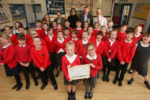 FCC presents the award for the waste free lunch at St Andrew's Cof E Primary School, Leasingham. EMN-190411-150222001