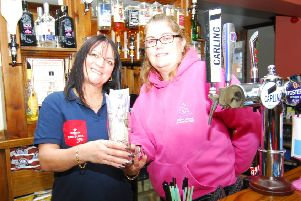 Andrea Newman, landlady of The Red Lion, presents her ?500 raised from staying sober for October to Liza Yeaman of Hollies Animal Rehoming Trust. EMN-191118-180144001